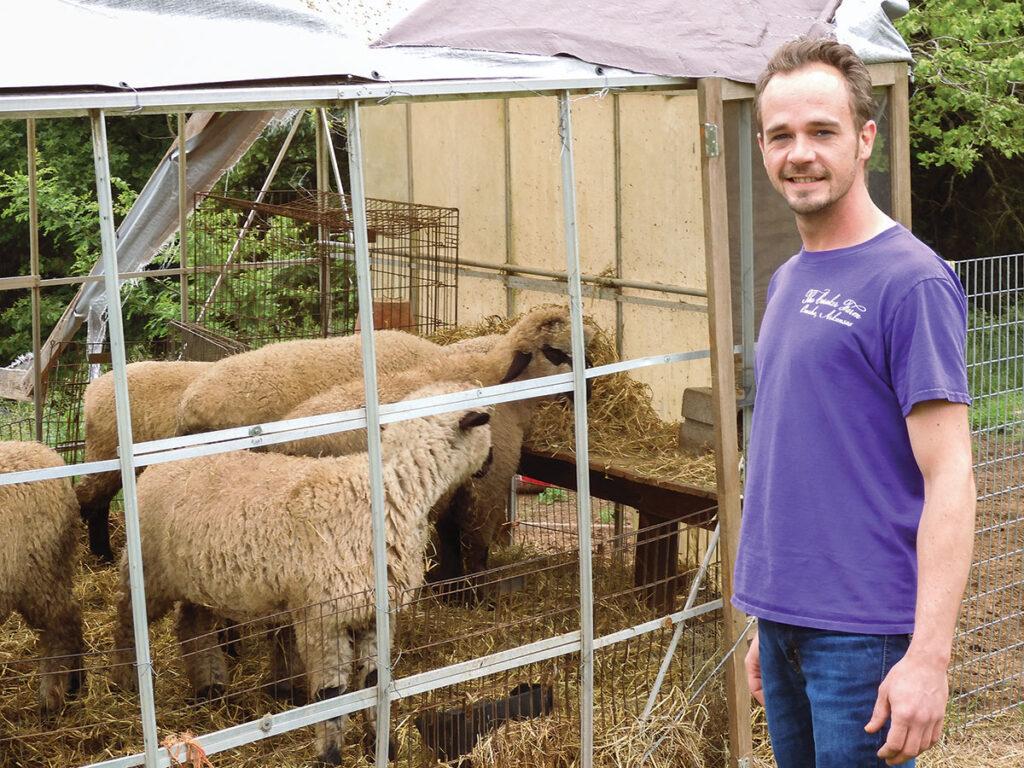 Brian Caraker with his sheep at his farm in Omaha, Arkansas. Photo by Terry Ropp.