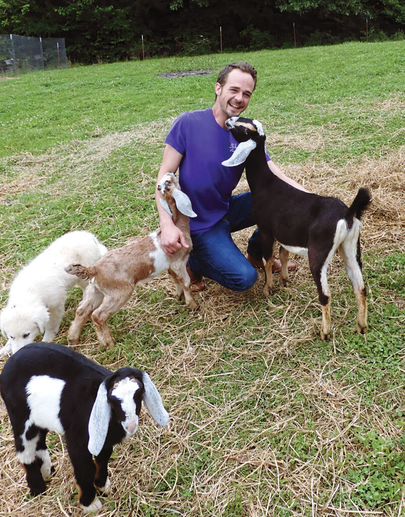 Brian Caraker with his goats at his farm in Omaha, Arkansas. Photo by Terry Ropp.