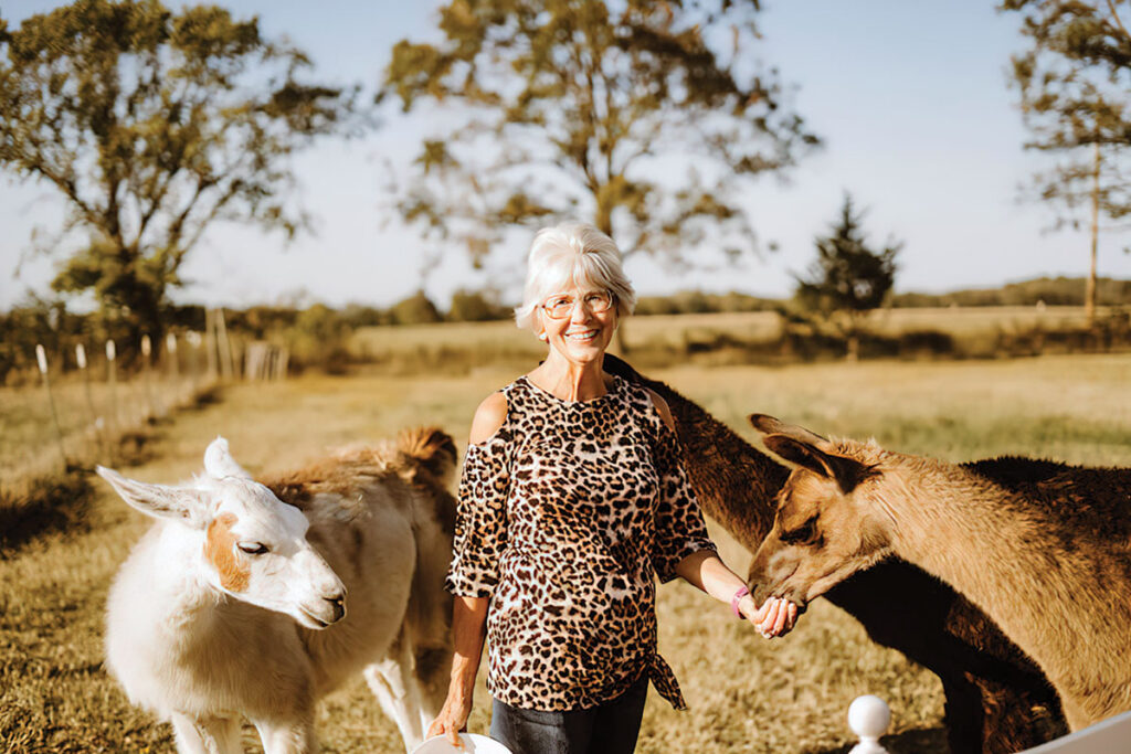 Myra Grayson with her llamas at Grays Lland Acres in Pryor Oklahoma. Submitted Photo.
