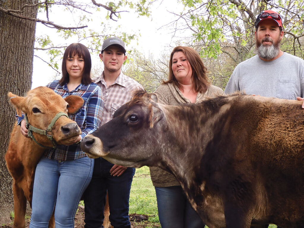 Howard family from Elkins, Ark., with their Jersey dairy cattle.