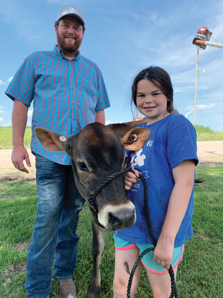 Scott VanZyverden and his daughter Harper are a part of the three-generation VanZyverden Dairy Farms operation near Ninagua, Mo.