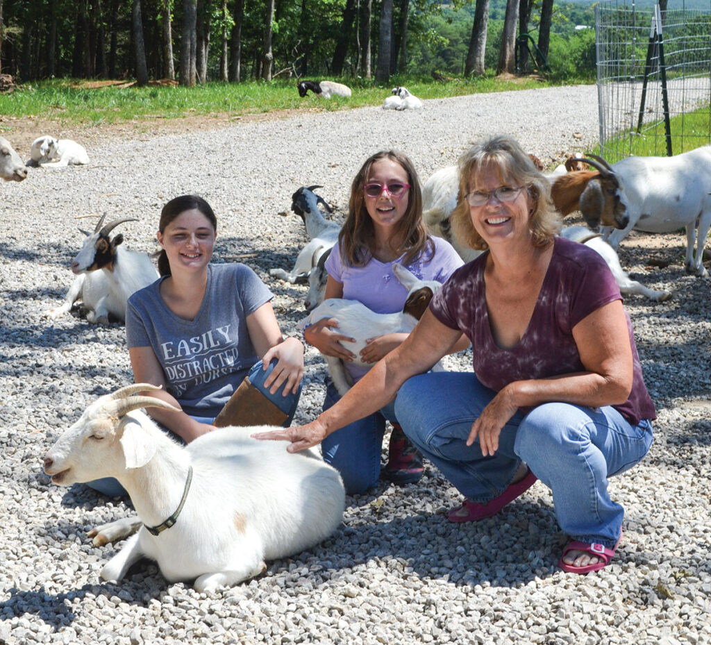 Loridian Bromberek-Reading, pictured with her granddaughters Emily Strohl (13) and Natalie Strohl (10), has a herd of mostly Boer-influenced goats, with some dairy animals as well. Photo by Laura L. Valenti.