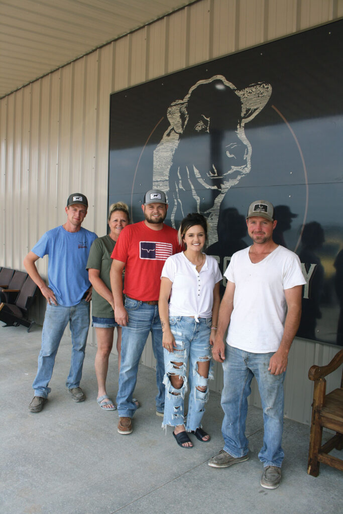 Employees outside Wright County Sale Barn. Photo by Julie Turner-Crawford.