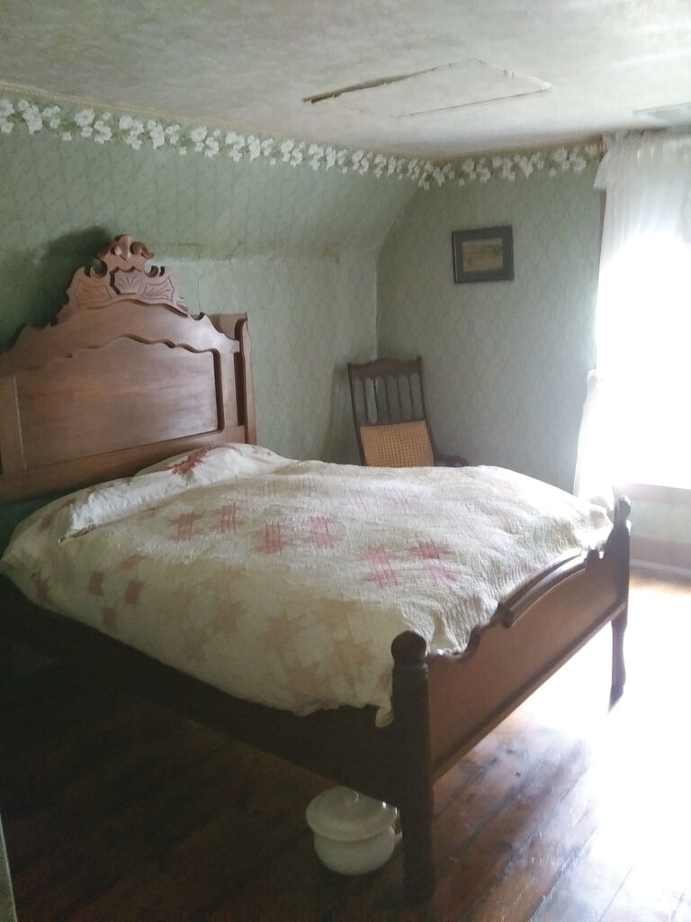 Bedroom with chamber pot under the bed. Submitted Photo.