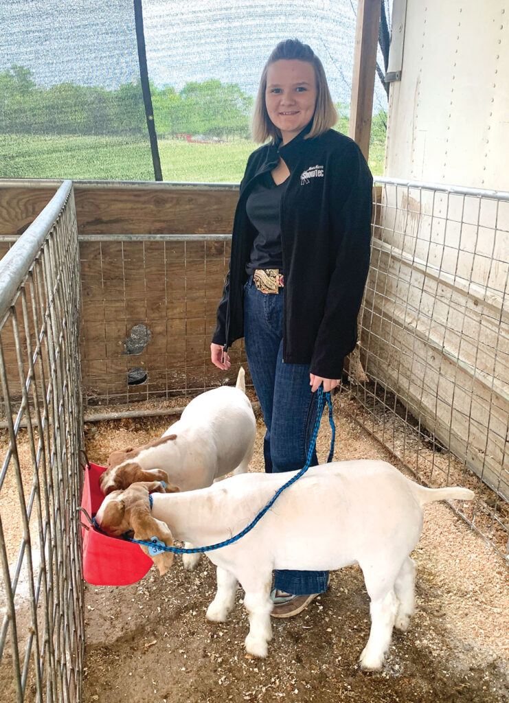 Callie Sweet with her goats. She is a member of the Diamond FFA chapter. Photo by Rachel Harper.