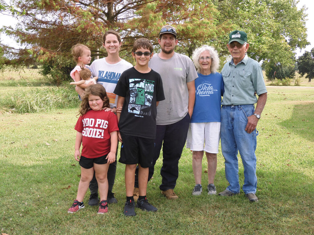 Clarence Woodward, pictured with his wife Pat, granddaughter Marcie Ketcher, her husband Colt, great-grandson Paxton, and great-granddaughters Kenedy and Timber, showed mechanical skills as a boy. Photo by Terry Ropp.