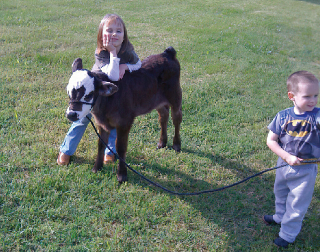 Kyla Moore, pictured her with her younger brother Keaton, was 5 years old when she got her first calf and began showing. Submitted Photo.