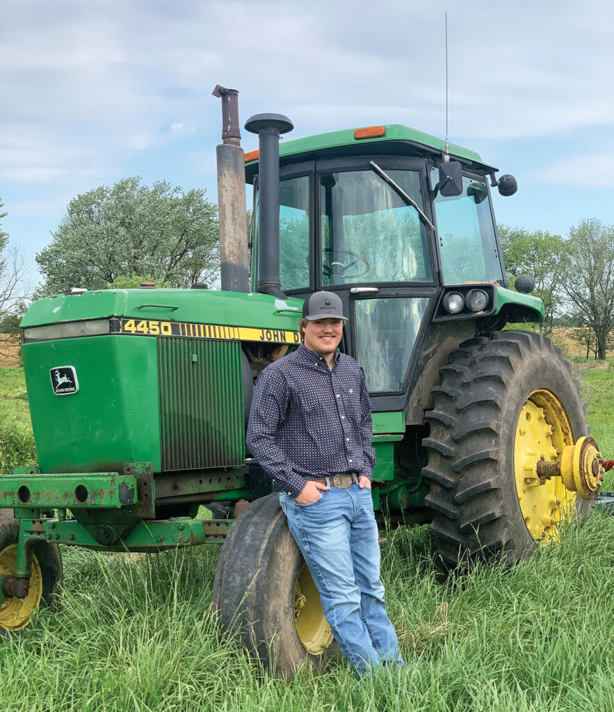 College freshman Austin Etcheson began working for Steel Rain Irrigation at a young age, which has allowed him to buy is own cattle and equipment. Photo by Rachel Harper.