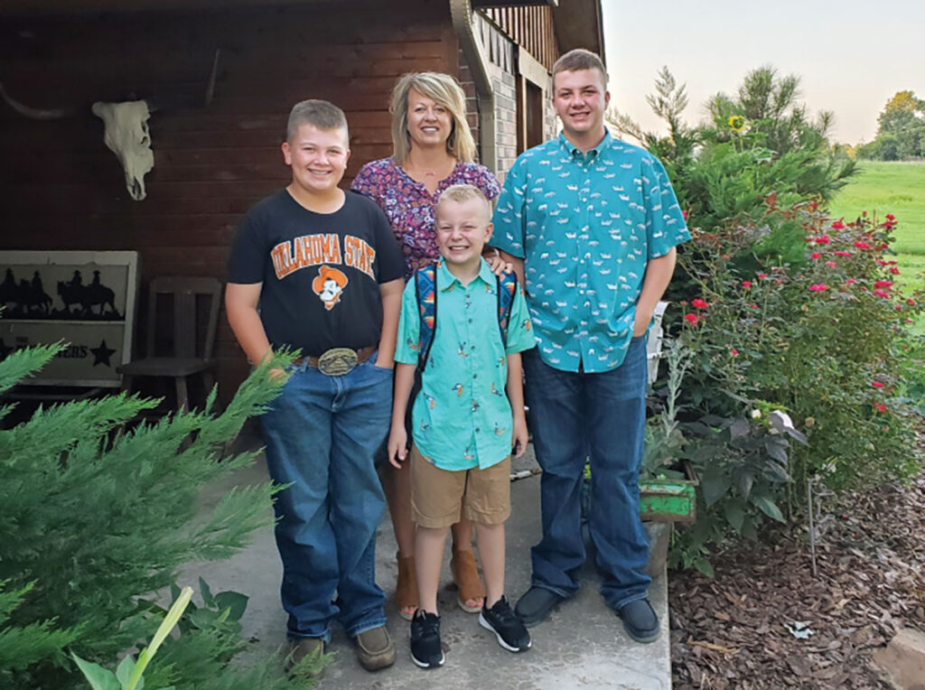DeLozier Livestock is a family operation. Pictured are Devin DeLozier's wife Becky, and sons Dax, Dacen and Dade.
